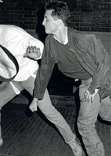 Sean Penn punching paparazzi, 1986.  Ron Galella